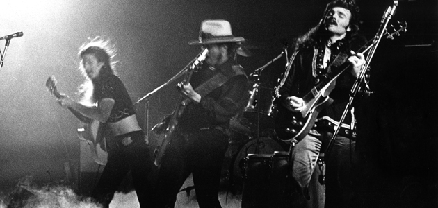 AMSTERDAM, NETHERLANDS - JANUARY 01: The Doobie Brothers perform live on stage at Concergebouw in Amsterdam, Netherlands in 1974 L-R Pat Simmons, Tiran Porter, Tom Johnston (Photo by Gijsbert Hanekroot/Redferns)