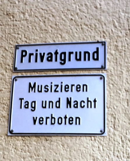 Funny sign on the way to HR Cafe: Private Property - musicians prohibited, day and night.